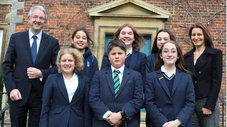 Lucy Frazer MP (Right) with John Attwater, the new Principal of King's Ely and students from the sch
