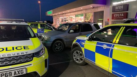 Trapped: Suspected hare coursers tackled by police at a garage forecourt. A police video released th