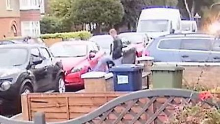 Man caught on camera repeatedly hitting a car for more than a minute in Badgeney Road, March. Pictur