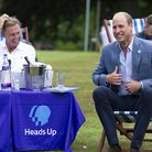 The Duke of Cambridge sits with former Arsenal player Tony Adams and representatives from Heads Up,