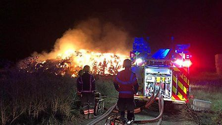 Firefighters tackling the stack fire near the A141 between Chatteris and Warboys Heath on Saturday,