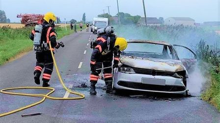 The Volkswagen car burst into flames on Benwick Road in Whittlesey on Saturday, August 15. Picture: