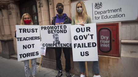 Students wearing face masks take part in a protest outside the Department for Education in Westminst