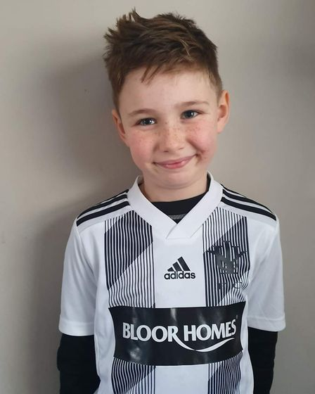 Callum Payne wearing the new Isleham Whites Under 9s kit sponsored by Bloor Homes. Picture: SUPPLIED