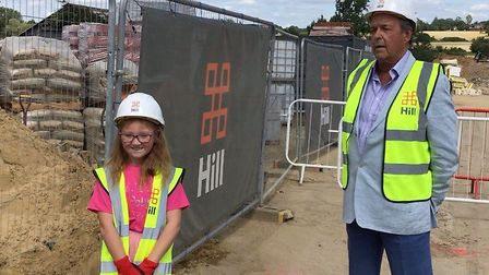 Polly Darby aged 8 and Councillor John Spence at Polly's Field Retirement Village development in Boc