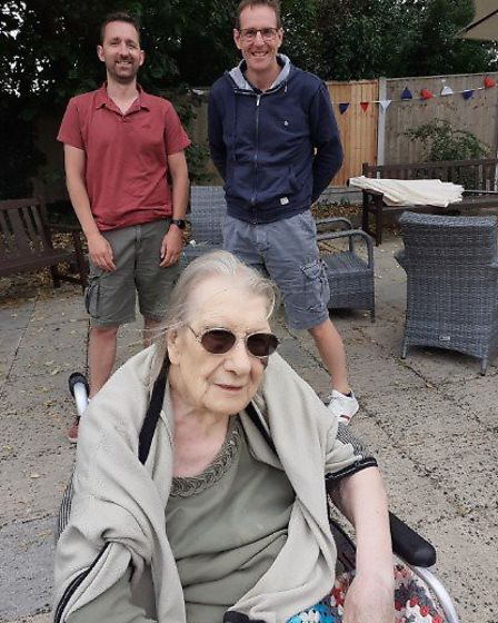 Joan Stock celebrated her 100th birthday in Great Dunmow, seen her with grandsons Garron and Jason t