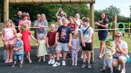 Councillor Susan Barker cuts the ribbon. New equipment has been installed in High Roding's play area