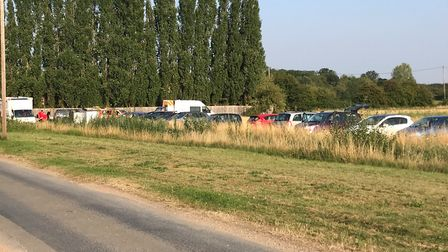 Members of the Cambridgeshire Search and Rescue team as well as police gathered on Bridge Lane, Wimb