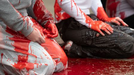 Grandparents from Extinction Rebellion pour fake blood over young people outside the Guildhall in Ca