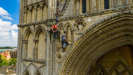 Stonemason Kate Holmes from Architectural & Heritage Scanning Ltd abseils down Peterborough Cathedra