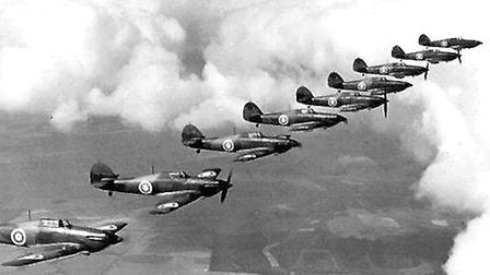 A Battle of Britain dogfight, an aerial battle between fighter aircraft conducted at close range.