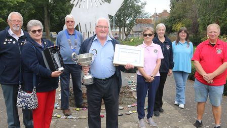 Whittlesey Lions club member Phil Knighton and netball player Ellie Nicholls, who has been voluntari