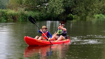 Peter Emeleus and his son Harry,12, paddled along the Great River Ouse on Monday (August 24). Pictur