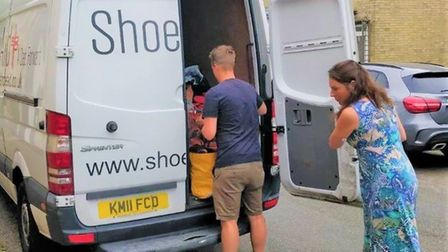 Residents in Ely came together as over 500 items of footwear were collected and donated to help Shoe