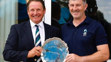 Men's captain Malvin Rogerson (left) with club championship scratch winner Lee Yearn. Picture: ELY C