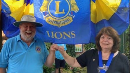 Littleport Lions past president Michael Stares handing over to new president Ann Ransley. Picture: D