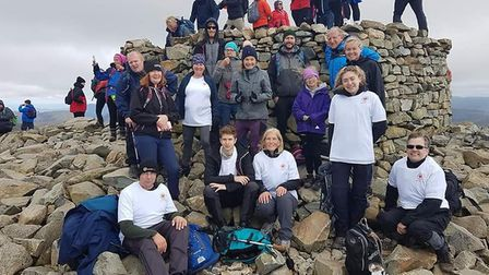 Fifteen climbers from Whittlesey raised more than £4,000 by climbing Scafell Pike, which is England'