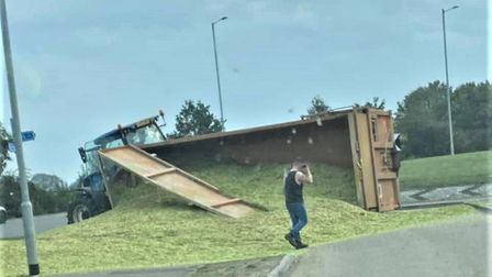 The tractor trailer overturned on the Lancaster Way roundabout on the A142 Witchford Road near Ely.