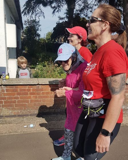 Roma O'Neil and Tamara Thompson were joined by mother Audrey Hindle for the last few metres of their