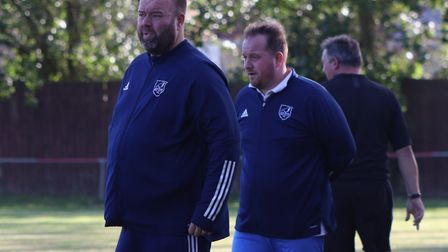 Luke McAvoy (left) and Ben Farmer watch on during Ely City's FA Vase defeat at Downham Town. Picture