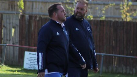 Ben Farmer (left) and Luke McAvoy return to the dugout as Ely City took on Downham Town in the FA Va