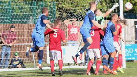 Ely City in action during their FA Vase first qualifying round defeat at Downham Town. Picture: DAN