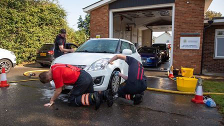The 'wash and go' firefighters of Sutton, Cambridgeshire, getting down to the annual car wash in aid
