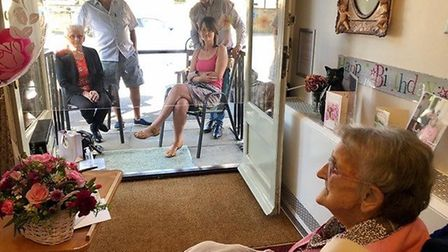 Lilian Taylor's family was able to visit her at a distance on her 102nd birthday. Pictures: The Herm