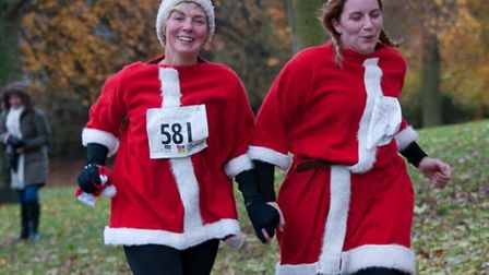 Festively-dressed fun participants at previous years' of Arthur Rank Hospice Charity's Festive 5K. T