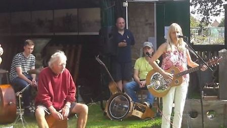 Local musicians sing songs written for Burwell Windmill for the first time at folk heritage day. Pic