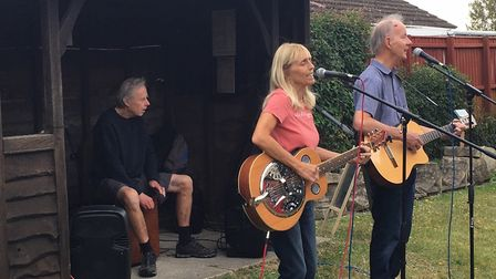 Local musicians sang songs written for Burwell Windmill for the first time at folk heritage day. Pic