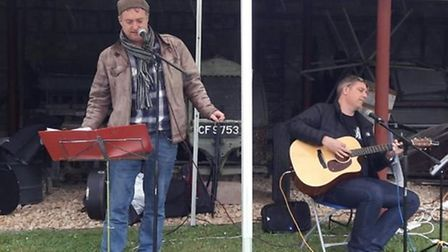Local musicians sing songs written for Burwell Windmill for the first time at folk heritage day; Dir