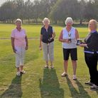 Emma presenting the March Golf Club competition winners with their prizes.