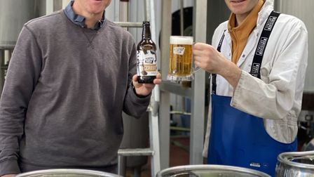 Braintree brewery Bishop Nick's director Nelion Ridley and Head Brewer Alex Ratter holding a pint of