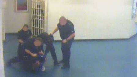 Prison officer Neil Trundle on the ground as other staf come to his aid.
