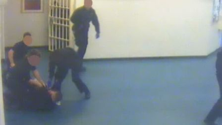 Pixelated images from the attack at Whitemoor. Two inmates are on trial following the attack.