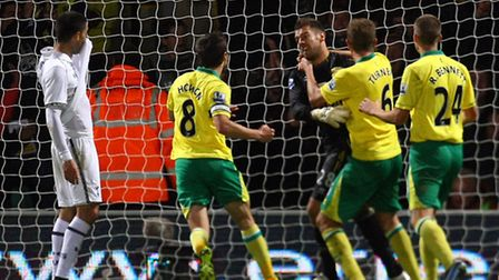 Mark Bunn saves Clint Dempsey's penalty in Norwich City's League Cup win over Tottenham Hotspur at C