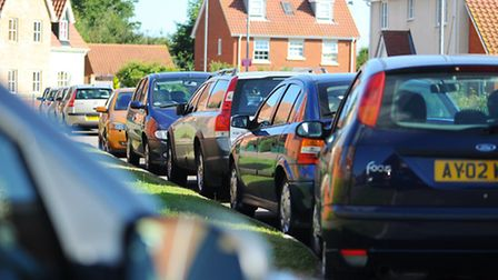 Cars parking along Jenner Road on the approach to one of the staff entrances to the James Paget Hosp