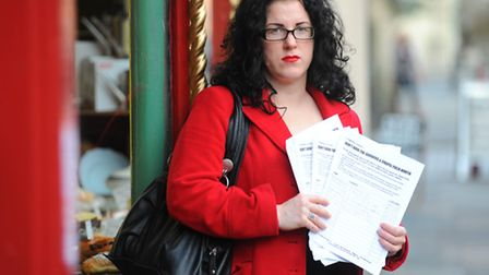 Dominy Jones from Louis' in Upper St Giles with the petition.Photo: Steve Adams
