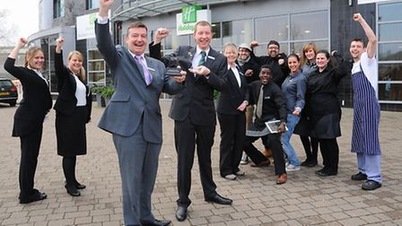 Holiday Inn Norwich City general manager Bill Heath and his team celebrate winning the Great Hotels