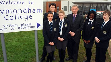 Principle of Wymondham College Melvyn Roffe celebrates an outstanding Ofsted report with students. P