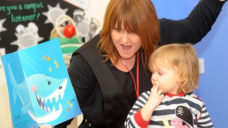 Sue Barton of the Harvest Childrens Centre in Brandon reads a story to the youngsters. Photograph Si