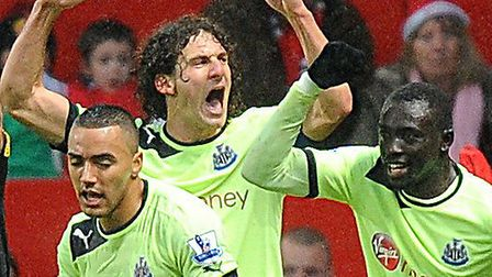 Fabricio Coloccini centre), who has been linked with a move away from Newcastle, celebrates a goal a