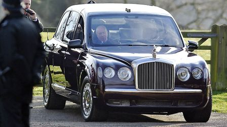 The Queen's chauffeur looks on as he has trouble starting the car. Picture: Matthew Usher.