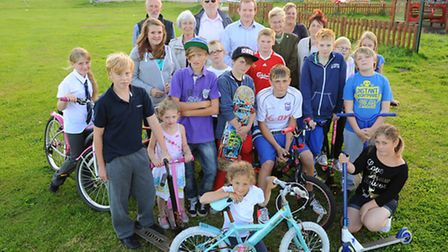 Kessingland skatepark plans backed.Youngsters and parish councillors on the proposed site on the pla
