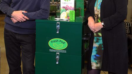 Valerie Watson-Brown of Fresh Pod with one of the cold filtration units with Mick Grossman of ComTek