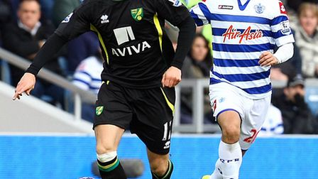 Norwich midfielder Anthony Pilkington in early action at QPR prior to his injury exit which has scup