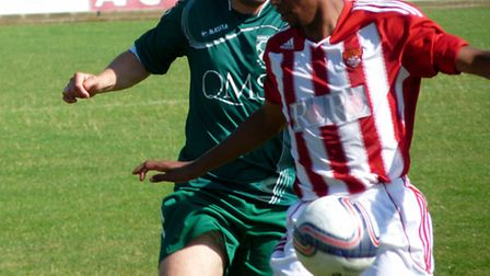 Ricci Butler, left, scored four for new leaders Acle.