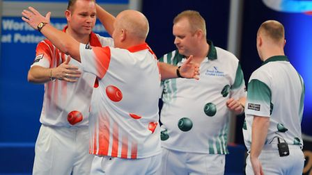 Alex Marshall (second from left) embraces Paul Foster after winning the pairs by beating fellow Scot