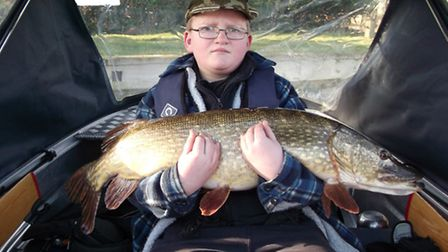 Lewis Bunting, 15, with his personal best 24lb 3oz pike caught from the River Bure. He wins a £50 sp